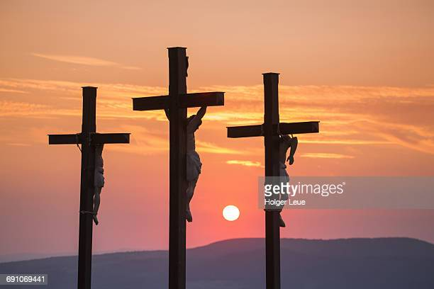 summit cross on kreuzberg mountain at sunset - crucifix stock pictures, royalty-free photos & images