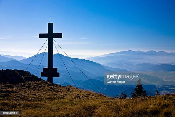 Summit cross (1629m) Rennfeld with look at the Mugelkuppe and Hochalpe Styria Austria