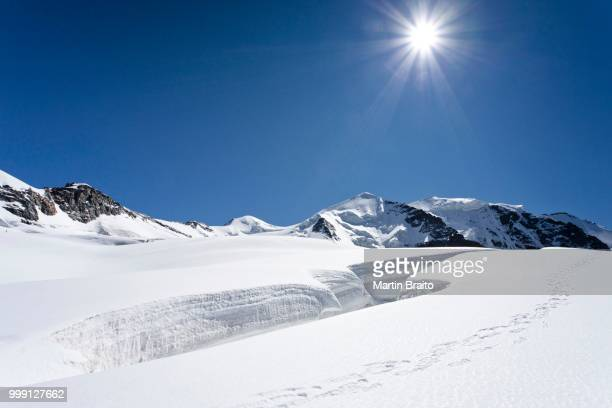 summit of mt piz palu in glacial landscape, grisons, switzerland - crevasse stock photos and pictures