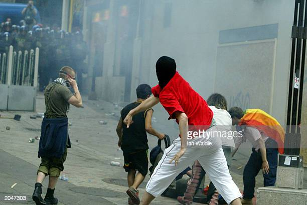 g8 summit protests in geneva - riot stock pictures, royalty-free photos & images
