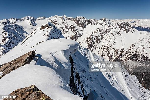 summit ridge with overhanging snow en route to mt laaser orgelspitze in val martello, martelltal valley, and the stelvio national park, ortler alps with mt king, mt zebru and mt ortler, vinschgau, south tyrol, trentino-alto adige, italy - martell valley italy stock photos and pictures