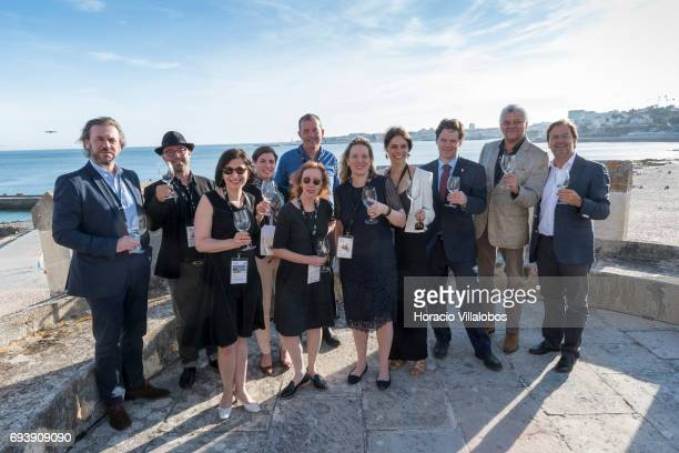 Summit speakers and executives pose for pictures during a gettogether in Forte da Cruz at the end of the second day of MUST Fermenting Ideas Wine...