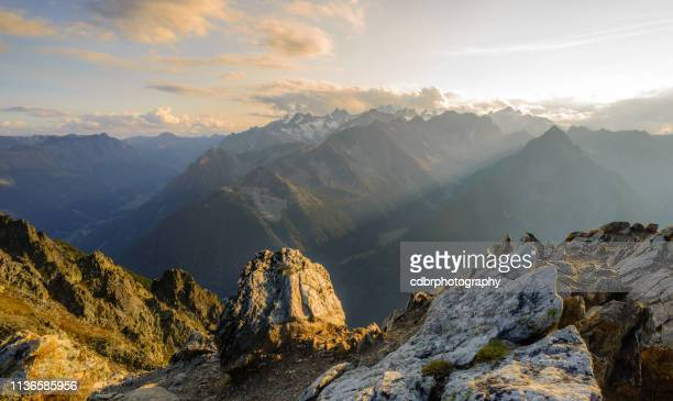 summit sunset in the swiss alps - mountain stock pictures, royalty-free photos & images