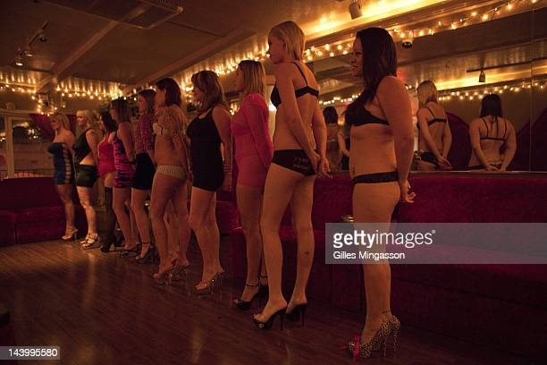 Summoned by a loud speaker upo a new client's arrival prostitutes line up to be inspected and hope to be choosen on November 18 2010 at the Love...
