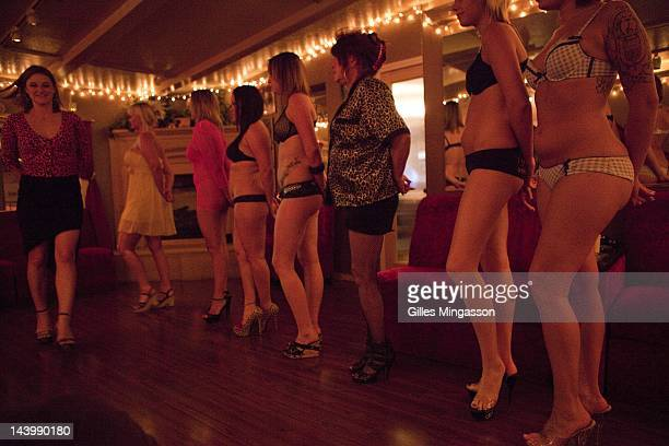 Summoned by a loud speaker upon a new client's arrival prostitutes line up to be inspected on November 18 2010 at the Love Ranch a brothel located on...