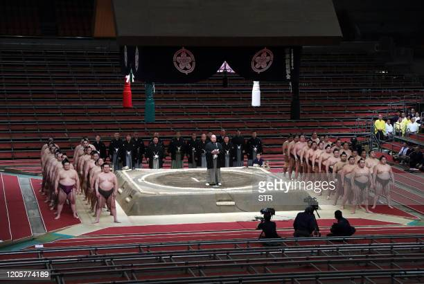 Sumo Association chairman Hakkaku greets sumo wrestlers during the spring grand sumo tournament held behind closed doors due to the outbreak of the...