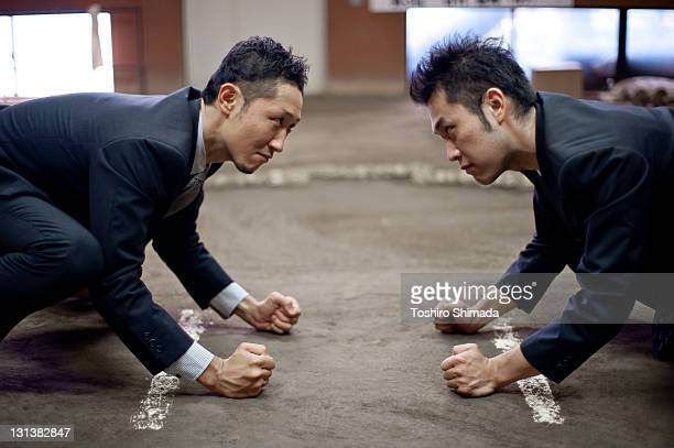 sumo businessman - sumo wrestling stock pictures, royalty-free photos & images