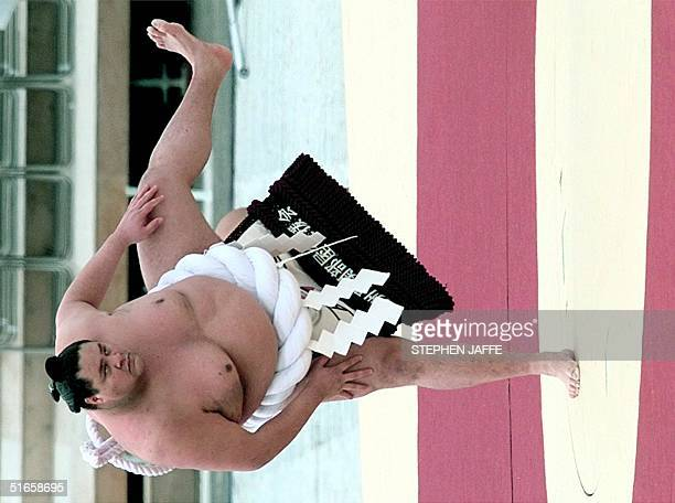 Sumo grand champion Akebono performs a ringentering ceremony to drive out the evil spirits at Minami Nagano Sports Park at the Opening Ceremony of...