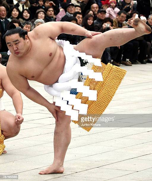 Sumo Grand Champion Asashoryu real name Dolgorsuren Dagvadorj performs 'dohyoiri' in a new ceremonial rope belt at the Meiji Shrine welcoming the new...