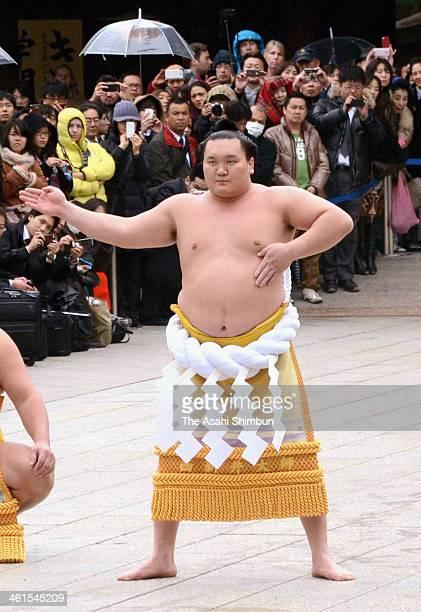 Sumo Grand Champion Hakuho performs 'Dohyoiri' during Dezuiri ceremony at the Meiji Shrine on January 8 2014 in Tokyo Japan