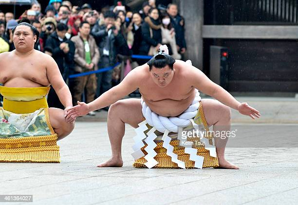 Sumo Grand Champion Hakuho Sho performs 'Dohyoiri' during Dezuiri ceremony at the Meiji Shrine on January 8 2014 in Tokyo Japan It is a custom for...