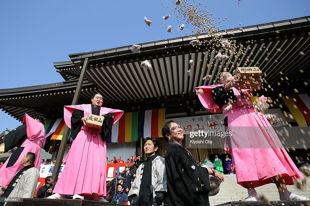 Sumo Grand Champion Hakuho (R), whose real name is Munkhbat Davaajargal, scatters packs of beans as Sumo Grand Champion Asashoryu (C), whose real name is Dolgorsuren Dagvadorj, looks on during a bean-scattering ceremony at Shinshoji Temple on February 3, 2009 in Narita, Chiba, Japan. The ceremony is held all over Japan on Setsubun which is the name of the day before the beginning of each season, which in this case is on February 3 or 4, one day before the start of spring according to the Japanese lunar calendar. It has been said that throwing beans drives out misfortune and brings in good luck.