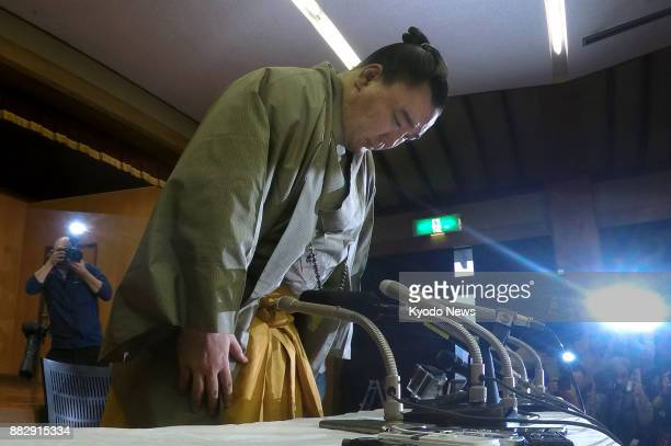 Sumo grand champion Harumafuji bows in apology during a press conference in Dazaifu Fukuoka Prefecture on Nov 29 where he announced his retirement...