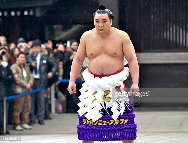Sumo Grand Champion Harumafuji Kohei performs 'Dohyoiri' during Dezuiri ceremony at the Meiji Shrine on January 8 2014 in Tokyo Japan It is a custom...