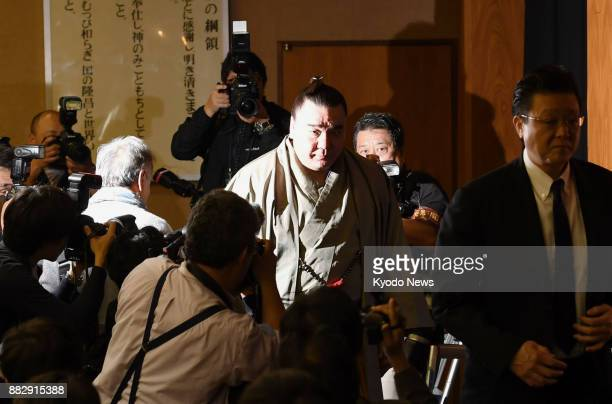 Sumo grand champion Harumafuji leaves a press conference in Dazaifu Fukuoka Prefecture on Nov 29 after announcing his retirement over an assault in...