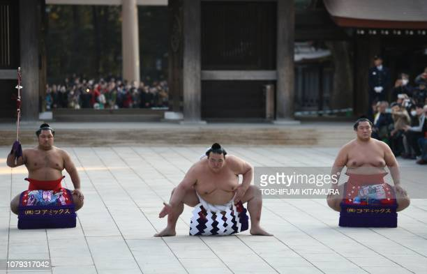 Sumo grand champion or yokozuna Kisenosato of Japan accompanied by Shohozan the tachimochi or swordbearer and Kagayaki the tsuyuharai or outrider...