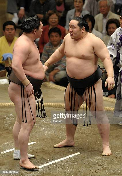 Sumo grand champions Hakuho and Asashoryu square off against each other on the day fifteen of the Grand Sumo Summer Tournament at Ryogoku Kokugikan...
