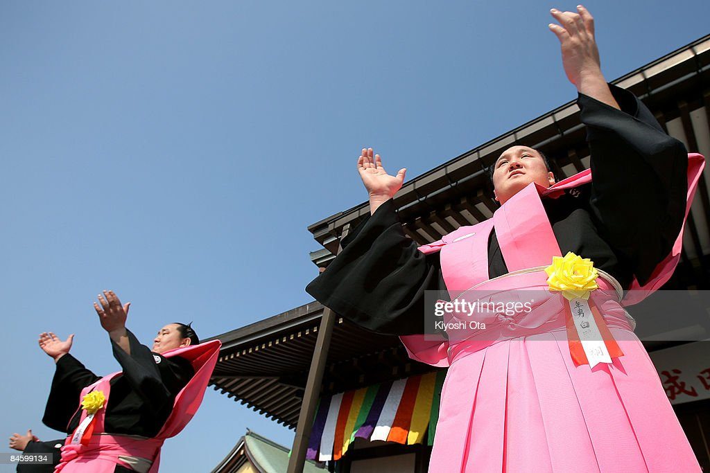 Sumo Grand Champions Hakuho (R), whose real name is Munkhbat Davaajargal, and Asashoryu, whose real name is Dolgorsuren Dagvadorj, applaud during a bean-scattering ceremony at Shinshoji Temple on February 3, 2009 in Narita, Chiba, Japan. The ceremony is held all over Japan on Setsubun which is the name of the day before the beginning of each season, which in this case is on February 3 or 4, one day before the start of spring according to the Japanese lunar calendar. It has been said that throwing beans drives out misfortune and brings in good luck.
