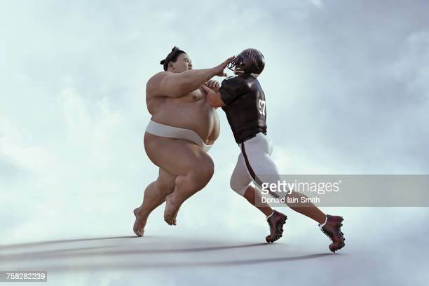 sumo wrestler and football player battling - wrestling stock pictures, royalty-free photos & images