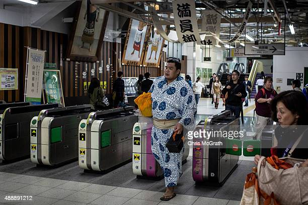 A sumo wrestler arrives via the subway ahead of the Tokyo Grand Sumo tournament at the Ryogoku Kokugikan on September 17 2015 in Tokyo Japan Japanese...