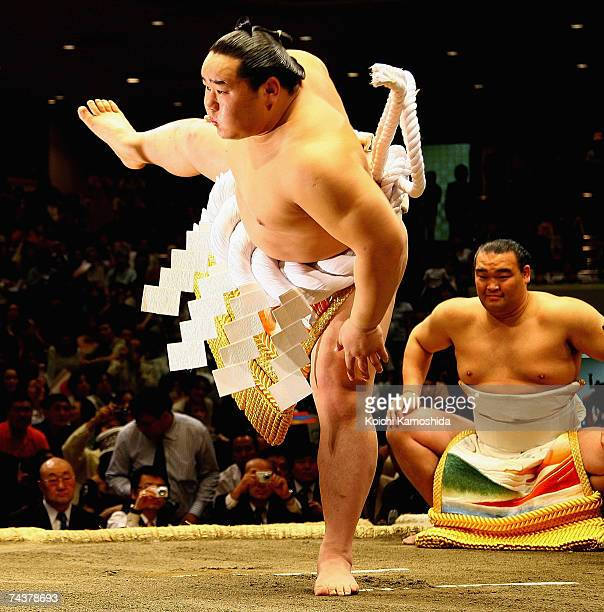 Sumo wrestler Asasyoryu of Mongolia performs a ritual during the Kyokushuzan Retirement Ceremony at the Kokugikan stadium June 2 2007 in Tokyo Japan