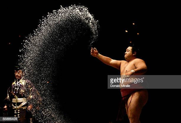 Sumo wrestler Chiyotaikai of Japan throws salt to purify the ring during the Grand Sumo Championship on October 9 2005 at Mandalay Bay Events Center...