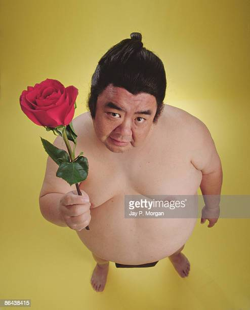 Sumo wrestler holding rose