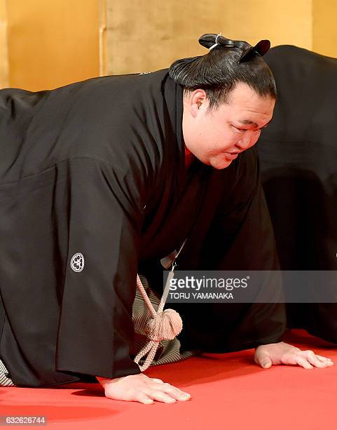 Sumo wrestler Kisenosato speaks after hearing from representatives from the Japan Sumo Association about his promotion to the top rank of 'yokozuna'...