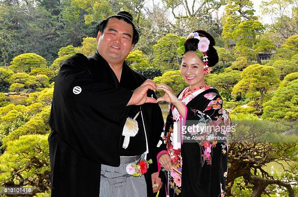 Sumo wrestler Kotoshogiku whose real name is Kazuhiro Kikutsugi and his wife Yumi pose for photographs prior to their wedding on February 27 2016 in...