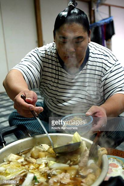 Sumo wrestler Kyokushuzan of Mongolia ranked Maegashira eats sumo wrestlers' stew which includes meat fish and vegetables after his first practice of...
