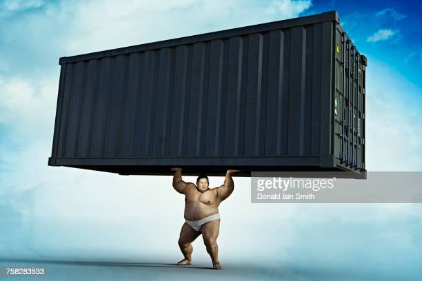 Sumo wrestler lifting cargo container