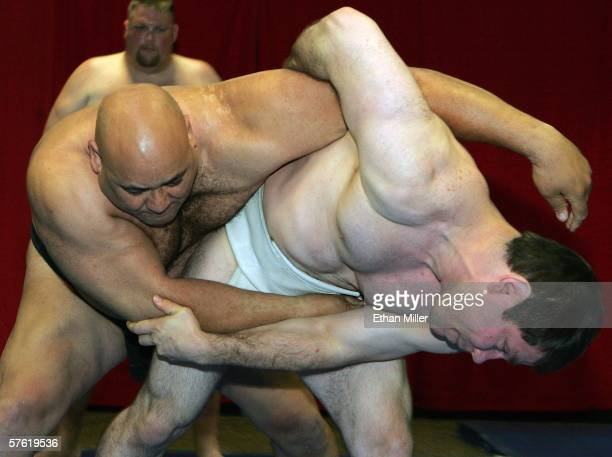 Sumo wrestler Ronny Allman of Norway and Stiliyan Georgiev of Bulgaria demonstrate wrestling techniques at the Thomas Mack Center as part of a news...