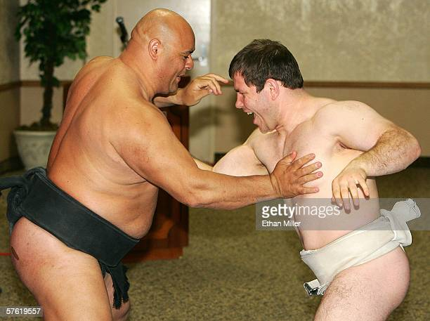 Sumo wrestler Ronny Allman of Norway and Stiliyan Georgiev of Bulgaria warm up at the Thomas Mack Center before holding a news conference to promote...