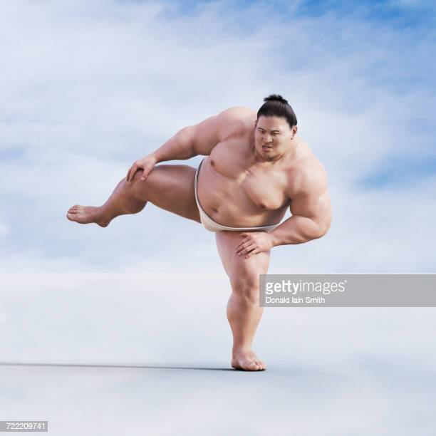 Sumo wrestler standing on one leg