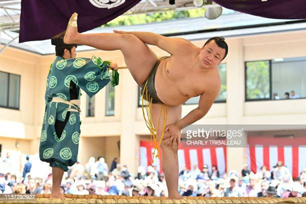 """Sumo wrestler takes part in a """"honozumo,"""" a ceremonial sumo exhibition, on the grounds of Yasukuni Shrine in Tokyo on April 15, 2019. - Sumo's top..."""