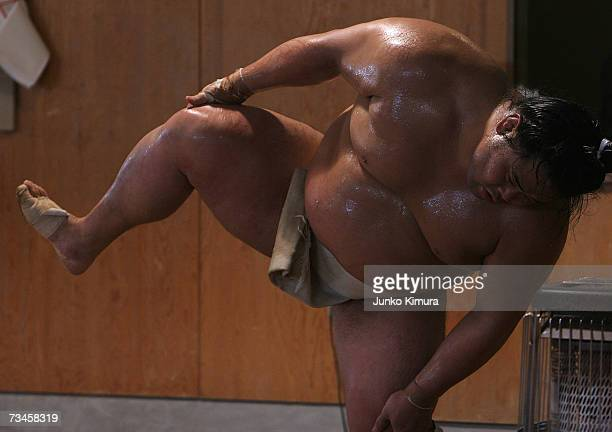 """Sumo wrestler takes part in a training session during a """"Sumo Diet Campaign"""" event at Musashigawa Sumo Stable on March 1, 2007 in Osaka, Japan. The..."""