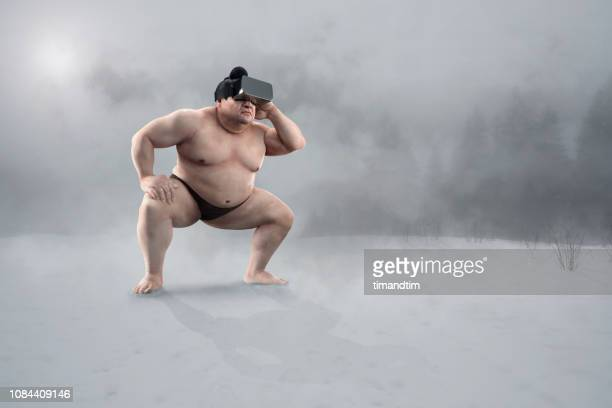 sumo wrestler using virtual reality headset having an  immersive experience - 相撲 ストックフォトと画像