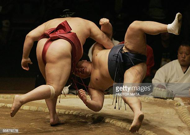 Sumo wrestler Wakatoba pushes his contender Ishide out of the Dohyo during the first round of the US Grand Sumo Championship at the Mandalay Bay...