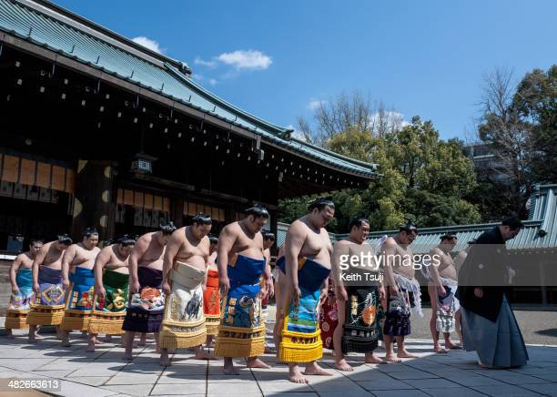 Sumo wrestlers are seen at the tournament ceremony during the Ceremonial Sumo Tournament or Honozumo at the Yasukuni Shrine on April 4 2014 in Tokyo...