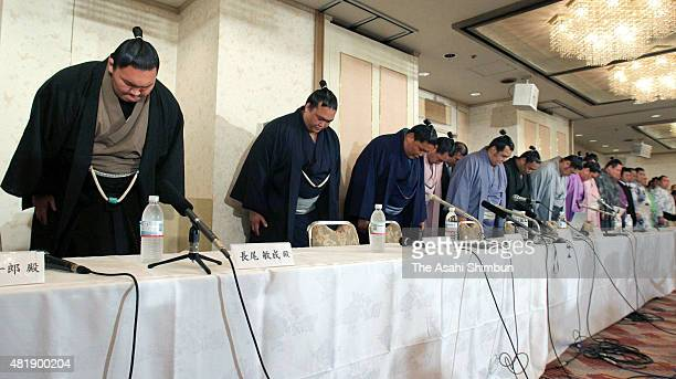 Sumo wrestlers bow for apology at the Japan Sumo Association's emergency executive meeting on baseball gambling among stable masters and wrestlers at...