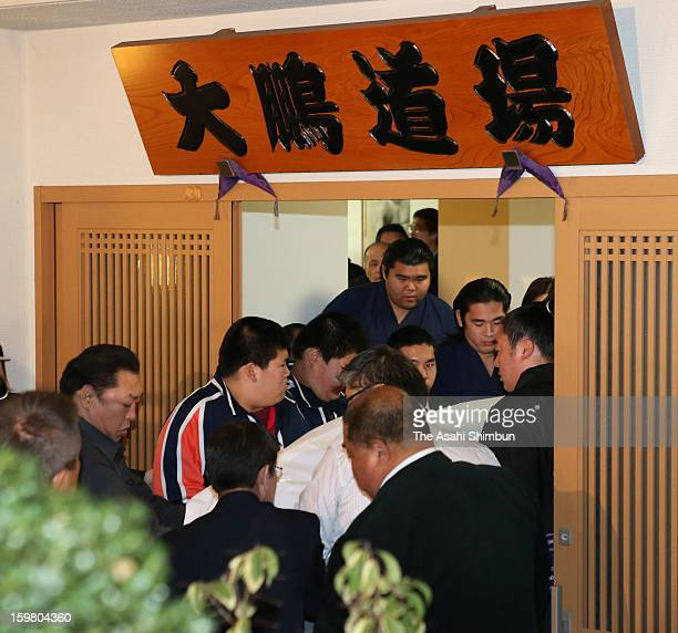 Sumo wrestlers carry the coffin of Former yokozuna sumo grand champion Taiho whose real name is Koki Naya who died at 72 to Otake Stable on January...