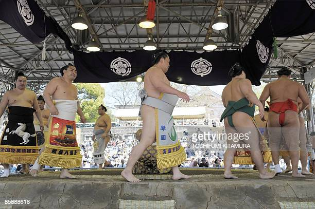 "Sumo wrestlers during the ""Honozumo,"" a ceremonial sumo tournament, at the Yasukuni shrine in Tokyo on April 7, 2009. Sumo Association dedicates the..."