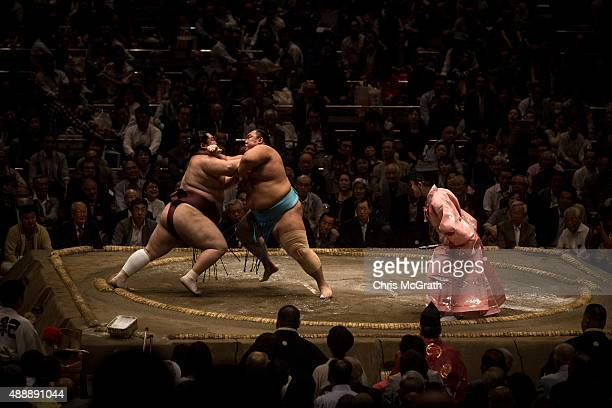 Sumo wrestlers fight during the Tokyo Grand Sumo tournament at the Ryogoku Kokugikan on September 17 2015 in Tokyo Japan Japanese Sumo is an anciant...
