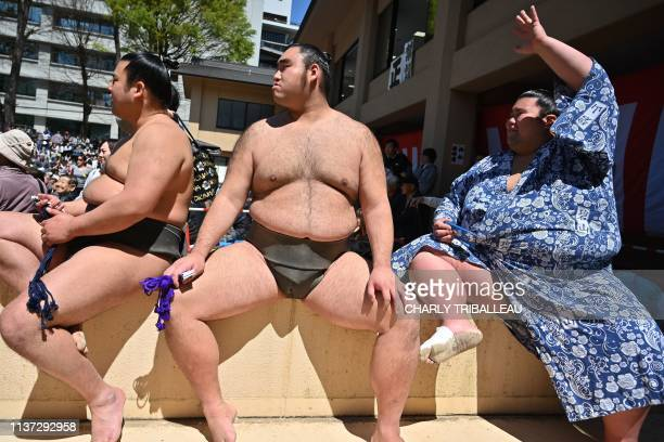 """Sumo wrestlers gather as they take part in a """"honozumo,"""" a ceremonial sumo exhibition, on the grounds of Yasukuni Shrine in Tokyo on April 15, 2019...."""