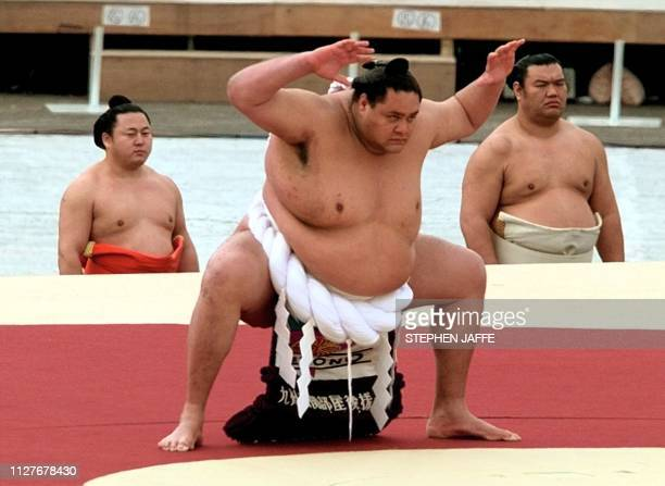 Sumo wrestlers led by Grand Champion Akebono take the stage at Minami Nagono Sports Park at the opening ceremony of the 18th Winter Olympics in...