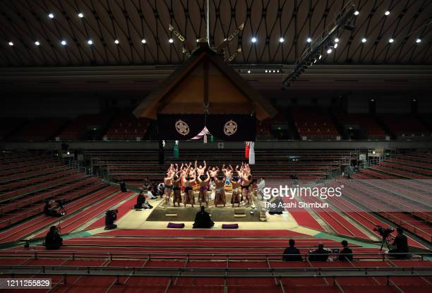 Sumo wrestlers perform the 'Dohyo-iri' ring purification rite on day one of the Grand Sumo Spring Tournament at Edion Arena Osaka on March 8, 2020 in...