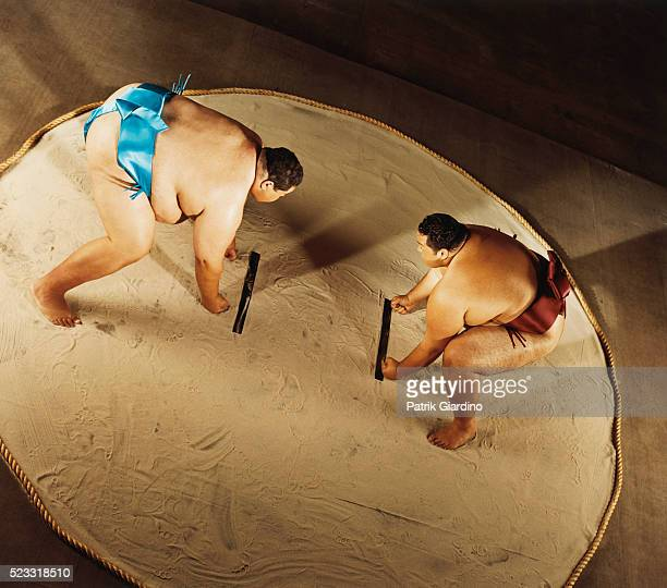 sumo wrestlers preparing to do battle - sumo wrestling stock pictures, royalty-free photos & images