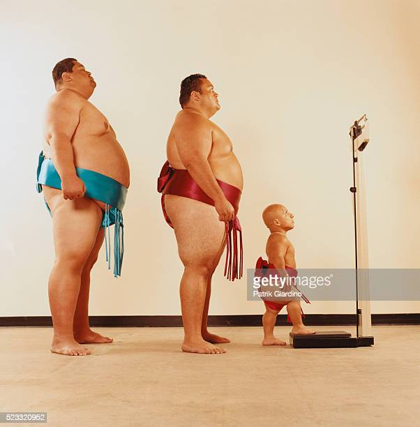 Sumo Wrestlers Preparing to Weigh Themselves