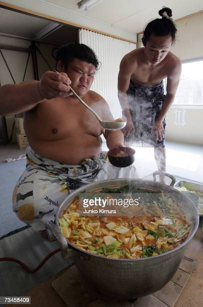 Sumo wrestlers serve up 'chankonabe' during a 'Sumo Diet Campaign' event at Musashigawa Sumo Stable on March 1 2007 in Osaka Japan The Sumo Stable...