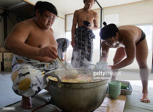 """Sumo wrestlers serve up 'chanko-nabe' during a """"Sumo Diet Campaign"""" event at Musashigawa Sumo Stable on March 1, 2007 in Osaka, Japan. The Sumo..."""